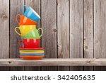 Colorful Coffee Cups On Shelf...
