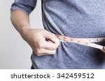 woman checking waistline | Shutterstock . vector #342459512