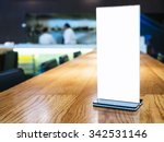 mock up menu frame on table in... | Shutterstock . vector #342531146