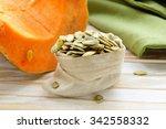 peeled pumpkin seeds and fresh... | Shutterstock . vector #342558332