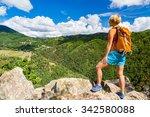 Hiking Woman Looking At...