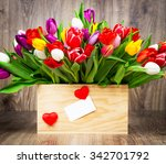 tulips in the box on wooden... | Shutterstock . vector #342701792