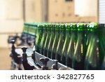 many bottles on conveyor belt... | Shutterstock . vector #342827765