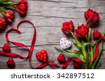 Stock photo valentines day background with chocolates hearts and red tulips 342897512