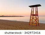 Small photo of Lifeguard tower on a beach in Palaio Faliro and dry dock of Alimos marina in Athens, Greece.