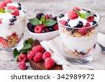 yogurt with muesli and berries... | Shutterstock . vector #342989972