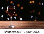 wine glass on wooden table... | Shutterstock . vector #343049066