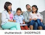 smiling family using tablet on... | Shutterstock . vector #343099625