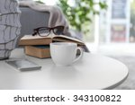 Cup Of Coffee With Books On...