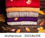 pile of knitted winter clothes... | Shutterstock . vector #343186358