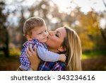 happy woman and her little son. ... | Shutterstock . vector #343234616