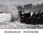 A Wave Crashing Against Rocks...