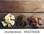 black  milk and white chocolate ... | Shutterstock . vector #343270328