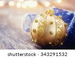 golden ball with blue ribbon on ... | Shutterstock . vector #343291532