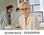 senior businesswoman standing... | Shutterstock . vector #343400948