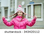 little kid girl in pink jacket... | Shutterstock . vector #343420112