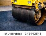 Small photo of Compact steamroller flatten out the asphalt.
