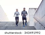 Small photo of fitness, sport, exercising, people and lifestyle concept - couple walking downstairs on stadium