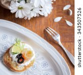Small photo of Delicious blintz with cream and salmon for healthy breakfast