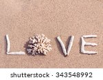 Word Love From Corals On Sand...