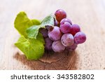 grapes on a old wooden table | Shutterstock . vector #343582802