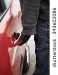 car thief trying door handle to ... | Shutterstock . vector #343602086
