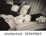 beautiful young girl on couch... | Shutterstock . vector #343645865