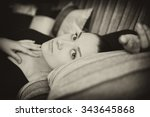 cute young girl on couch at home | Shutterstock . vector #343645868