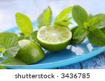 fresh herbs and lime, ingredients for a mojito cocktail - stock photo