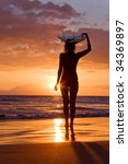 Surfer Girl With Surfboard At...