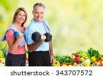 senior couple with dumbbell.... | Shutterstock . vector #343707572