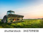tractor in a field on a... | Shutterstock . vector #343709858