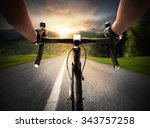 cyclist pedaling on a street in ... | Shutterstock . vector #343757258