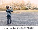 A Little Child Boy Outside...