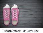 pink gumshoes on wooden... | Shutterstock .eps vector #343891622