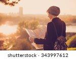 young female traveler standing... | Shutterstock . vector #343997612