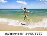 girl jumping and splashing in... | Shutterstock . vector #344075132
