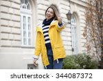 young beautiful girl in yellow... | Shutterstock . vector #344087372