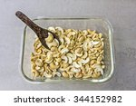 Small photo of Cashew Nut on tile surface - accessory fruit (Anacardium occidentale)