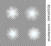vector set of glowing light... | Shutterstock .eps vector #344165528