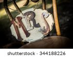Small photo of Homemade, rustic, distressed, brown wedding sign saying Mrs or Missus