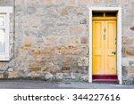 a yellow wooden front door in a ... | Shutterstock . vector #344227616