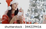 attractive festive young woman... | Shutterstock . vector #344229416