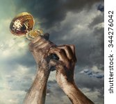 gold cup in dirty hands on sky... | Shutterstock . vector #344276042