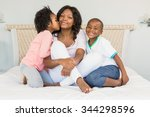 mother and children sitting on... | Shutterstock . vector #344298596