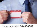 businessman attaching name tag... | Shutterstock . vector #344308382