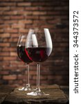 wine glasses on a wooden table... | Shutterstock . vector #344373572
