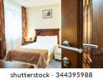 Stock photo hotel room or apartment doorway with open door and bedroom in background 344395988
