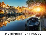 Stock photo amsterdam canal at sunset amsterdam is the capital and most populous city in netherlands 344403392