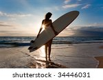 Woman With Surfboard And...